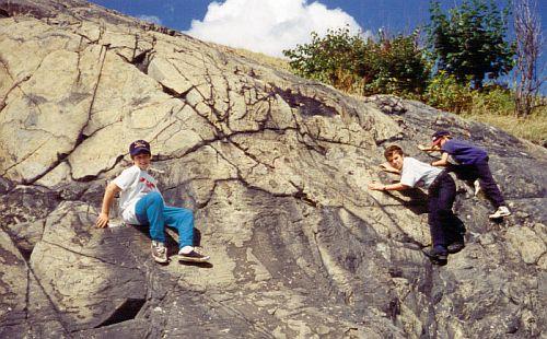 kids climbing rocks